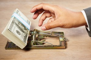 value-trap-mouse-trap-hand-with-money-getty_large